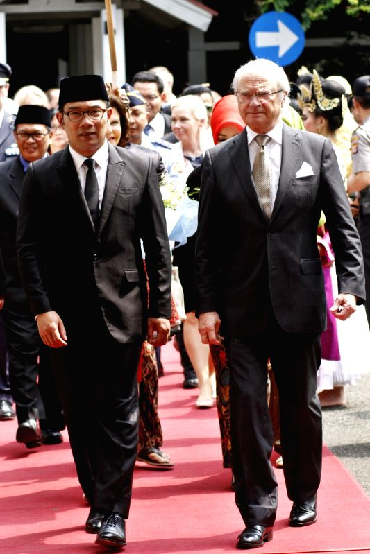 BANDUNG, May 24, 2017 - Swedish King Carl XVI Gustaf (front R) walks with Indonesia's Bandung Major Ridwan Kamil (front L) during an event of the king's visit in Bandung, West Java, Indonesia, May ...