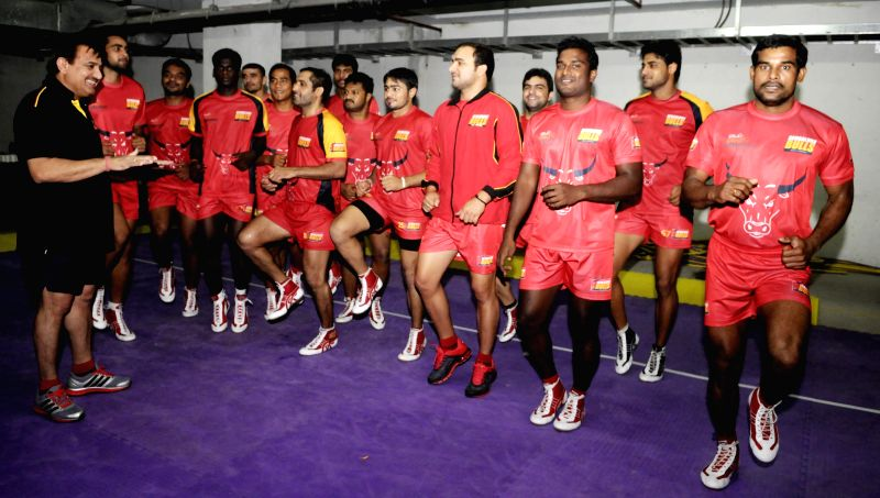 Bangalore Bulls kabaddi team members practice with coach Randhir Singh ahead of the Pro Kabbadi League matches in Bangalore on Aug. 23, 2014.