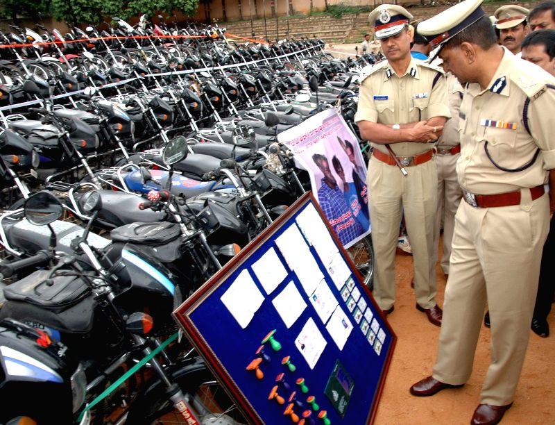 Bangalore City Police Commissioner MN Reddy inspects stolen motorcycles recovered during a property parade in Bangalore on Aug 27, 2014.