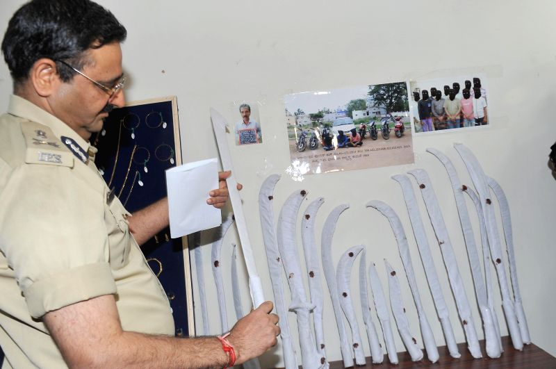 Bangalore City Police Commissioner Ragavendra Auradkar inspecting recovered jewels and cash, during press conference at Police Commissioner Office,, which were seized by Bangalore East Division ...