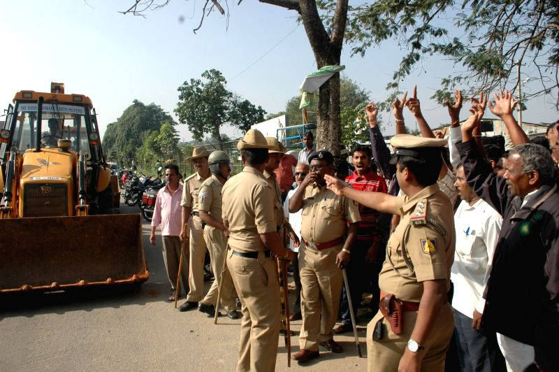 Devotees staging a protest against State Government and BBMP Concerned Authorities for demolition of the Kodandarama Temple which was built in a Lake Property at Kacharakanahalli, in ...