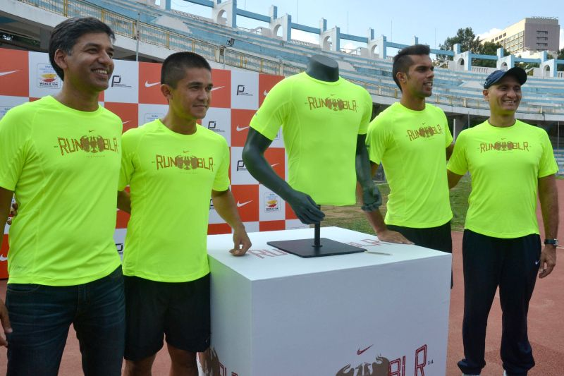 Bangalore Football Club captain Sunil Chhetri and footballer Robin Singh launch of a Tee-shirt that will be presented to top 1000 finishers at TCS World 10K Bangalore at Kanteerva Stadium in ... - Sunil Chhetri and Singh
