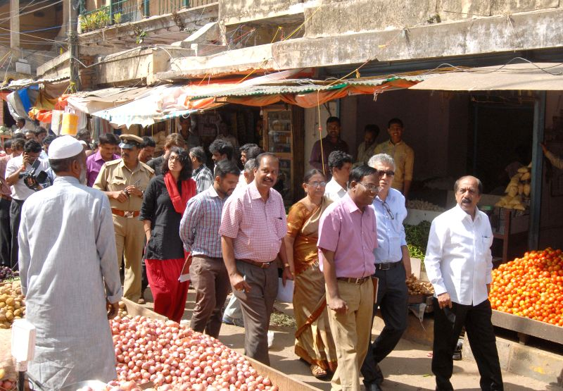 Bangalore Mayor B S Satyanarayana and officials of Sthayi Committee inspect KR Market for renovation in Bangalore on July 3, 2014.