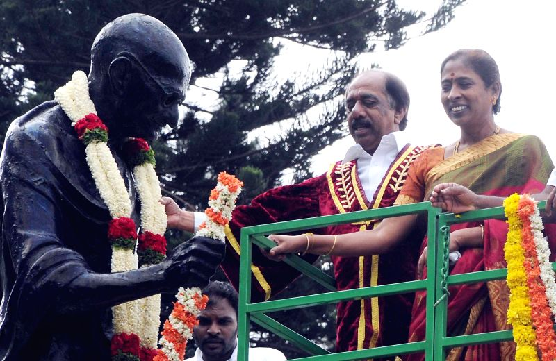 Bangalore Mayor Katte Satyanarayana with Deputy Mayor Indira garlanding the statue of  Mahatma Gandhi on occasion of ``Quit India Movement`` anniversary at in Bangalore on Aug.9, 2014.