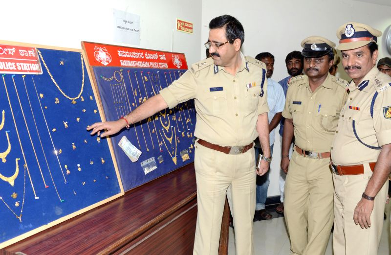 Bangalore Police Commissioner Raghavendra Auradkar inspects the stolen properties which were recovered by the polie and handed over to their owners during a press conference in Bangalore on April 24,
