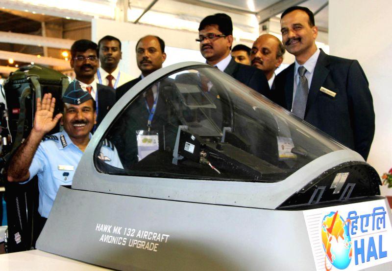The Chief of Air Staff, Air Chief Marshal Arup Raha in a HAWK MK 132 simulator at Hindustan Aeronautics Ltd., during the Aero India-2015, in Bangalore on Feb 19, 2015.