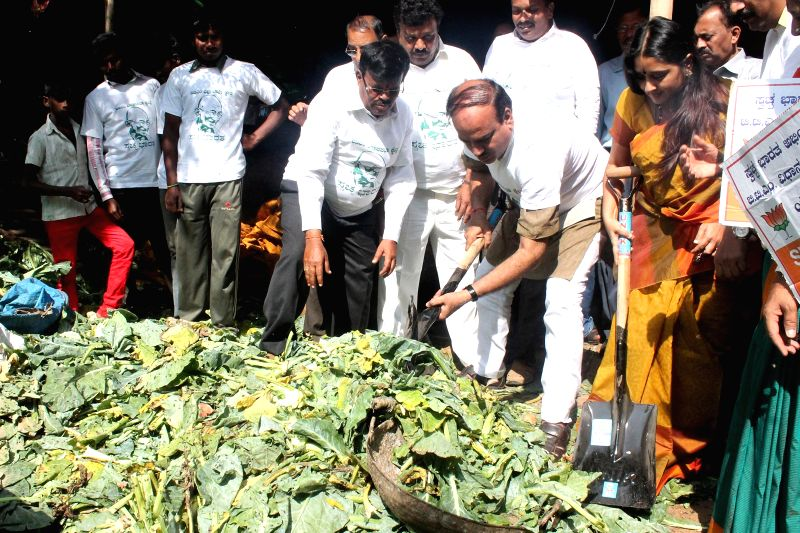 Union Minister Ananth Kumar with Malavika, BJP Leader partake in Swachh Bharat Abhiyaan at Madivala in Bengaluru on Nov 22, 2014. - Ananth Kumar