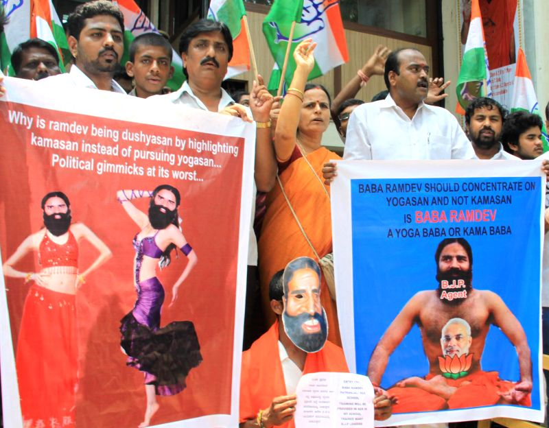 Bangalore Youth Congress activists protesting against Yoga Guru Baba Ramdev for his statement on Congress vice president Rahul Gandhi in Bangalore on April 26, 2014. - Rahul Gandhi