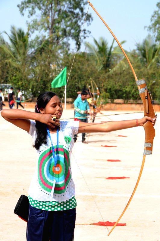 Participants take part during the 17th National Varanasi Archery Competition organised by Akhil Bharatiya Varanasi Kalyan Ashram at Vagedvi School, in Bangaluru, on Dec 27, 2014.