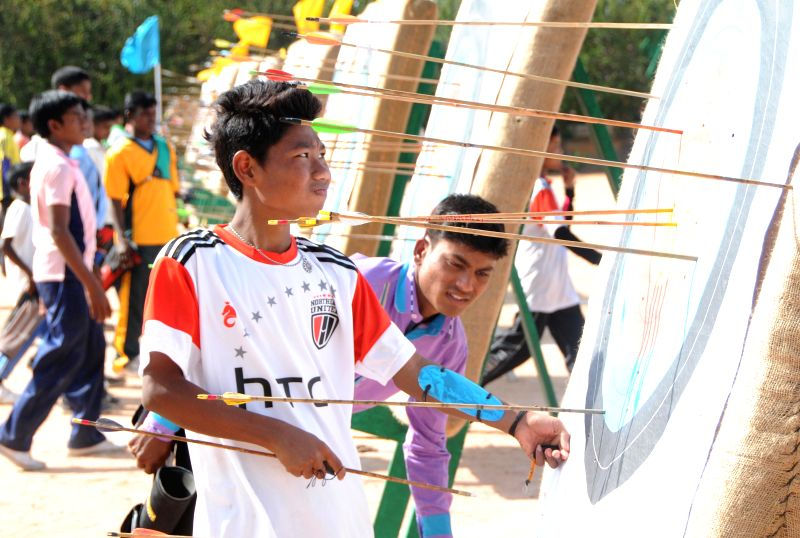Participants take part during the inauguration of the 17th National Varanasi Archery Competition organised by Akhil Bharatiya Varanasi Kalyan Ashram at Vagedvi School, in Bangaluru, on Dec