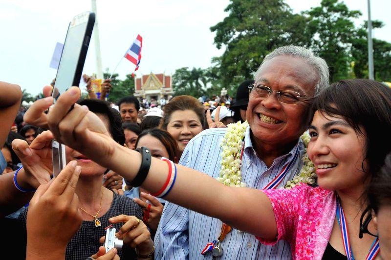 Anti-government protest leader Suthep Thaugsuban greets public health officials during an anti-government protest at Ministry of Public Health in Bangkok, ...
