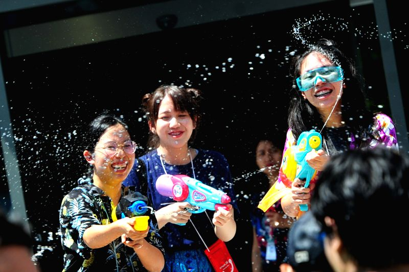 BANGKOK, April 13, 2018 - People take part in water gun battles during celebrations for Songkran Festival, Thailand's traditional New Year Festival, in Siam shopping district of Bangkok, Thailand, ...