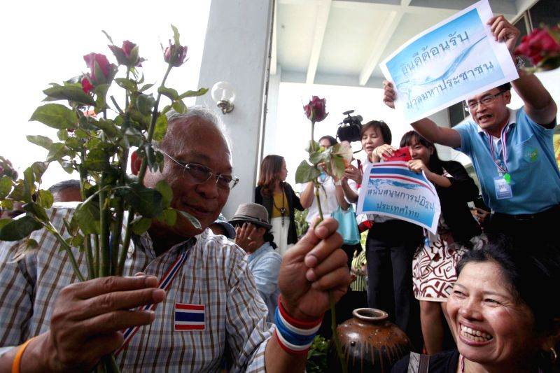 Anti-government protest leader Suthep Thaugsuban reacts among Metropolitan Waterworks Authority (MWA) officials during an anti-government protest at Metropolitan ..