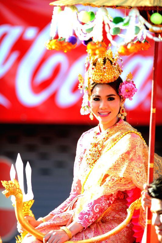 A lady takes part in a parade during the Songkran festival in Phra Pradaeng, outskirt Bangkok, Thailand, April 19, 2015. The Phra Pradaeng Songkran festival falls ...