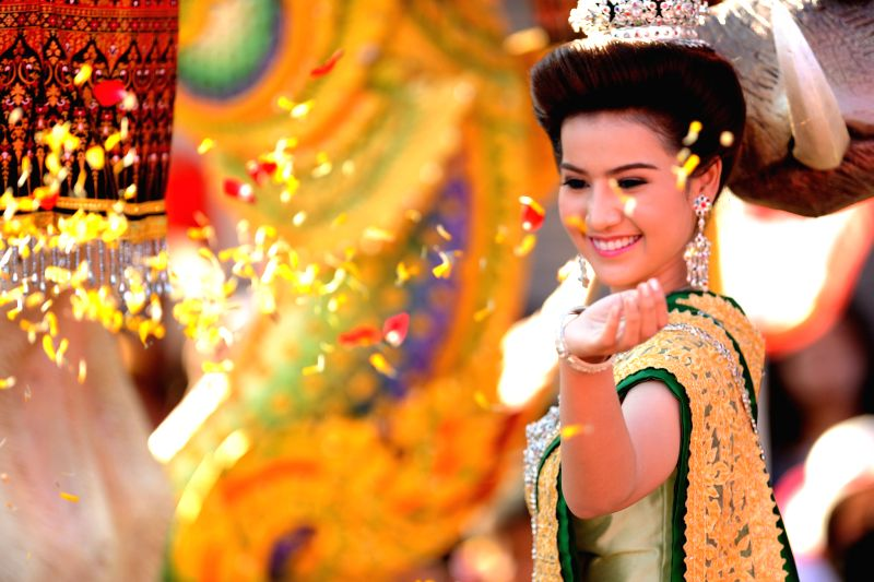 A woman takes part in a parade during the Songkran festival in Phra Pradaeng, on the outskirts of Bangkok, Thailand, April 19, 2015.