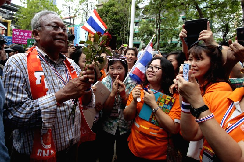 Anti-government protest leader Suthep Thaugsuban (L) greets Metropolitan Electricity Authority officials during an anti-government protest at Metropolitan ...