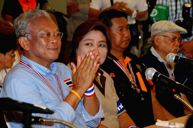 Thai anti-government protest leader Suthep Thaugsuban (L) attends a rally at Thailand Tobacco Monopoly in Bangkok, Thailand, April 28, 2014. (Xinhua/Rachen ...