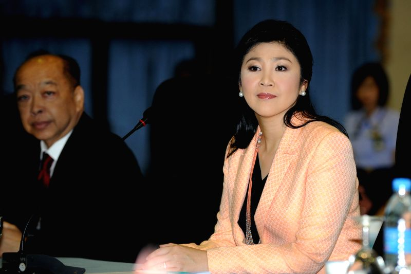 Thai caretaker Prime Minister Yingluck Shinawatra attends a meeting with the Election Commission (EC) at the Royal Thai Air Force Academy in Bangkok, Thailand, on .