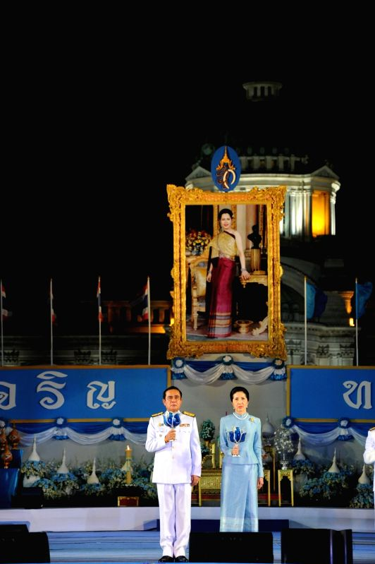 BANGKOK, Aug. 13, 2017 - Thai Prime Minister Prayuth Chan-ocha (L) and his wife Naraporn attend a candle-lighting ceremony to bless Queen Sirikit, the Queen Dowager of Thailand, at the Dusit Palace ... - Prayuth Chan