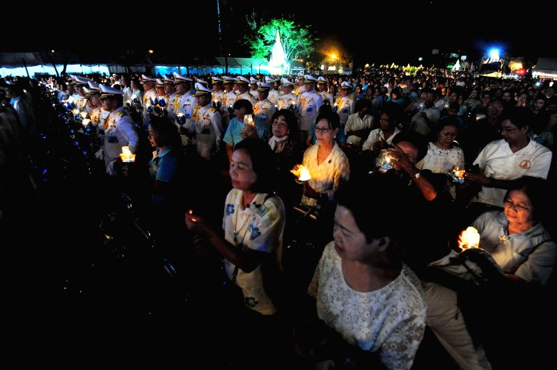 BANGKOK, Aug. 13, 2017 - Well-wishers pray for the health of Queen Sirikit, the Queen Dowager of Thailand, during a candle-lighting ceremony at the Dusit Palace Plaza in Bangkok, Thailand, Aug. 12, ...