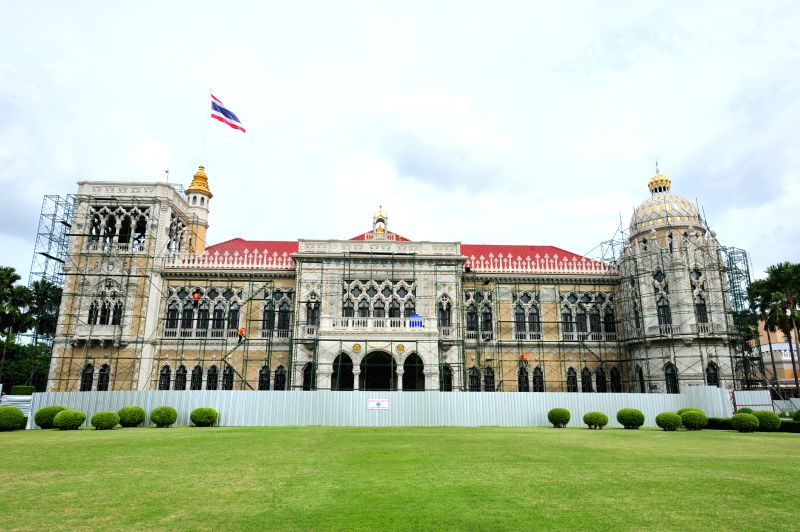 Thai workers decorate the exterior of Government House in Bangkok, Thailand, Aug. 14, 2014.