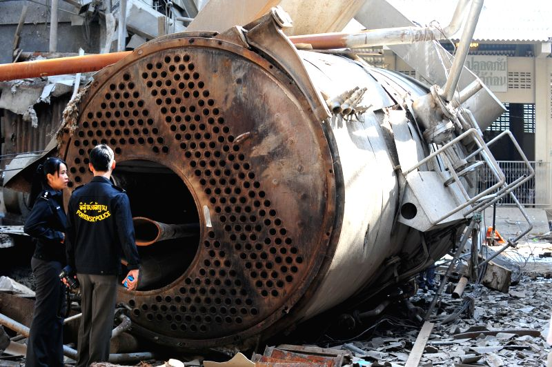 Police inspect the site of explosion near Bangkok, Thailand, Aug. 19, 2014. A large boiler in a cloth dyeing factory exploded on Sunday morning, causing 22 people ..