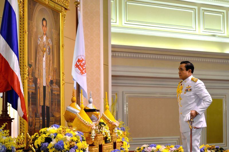Thai junta chief Prayuth Chan-ocha pays his respect as he receives the royal endorsement, in front of a portrait of Thai King Bhumibol Adulyadej, at the Royal Army .