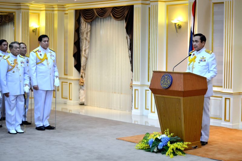 Thai junta chief Prayuth Chan-ocha (R) speaks after receiving a royal command formally appointing him the 29th prime minister of the country, on Aug. 25, 2014.  ...