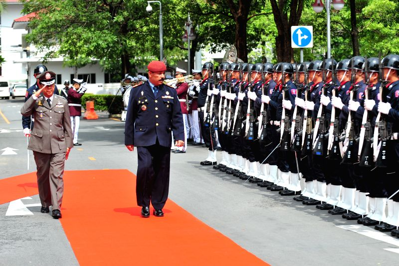 Thailand's acting police chief Gen. Watcharapol Prasanratchakit (L) and Timor-Leste's police chief Gen. Longuinhos Castro Monteiro review an honor guard during a ...