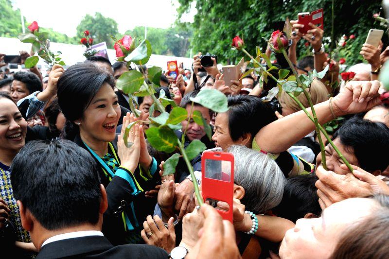 BANGKOK, Aug. 5, 2016 - Thailand's former prime minister Yingluck Shinawatra waves to supporters before a court hearing over a rice subsidy scheme in Bangkok, capital of Thailand, on Aug. 5, 2016. ... - Yingluck Shinawatra