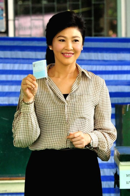 BANGKOK, Aug. 7, 2016 - Former Thai Prime Minister Yingluck Shinawatra demonstrates her ballot during a constitutional referendum at a polling place in Bangkok, Thailand, Aug. 7, 2016. Citizens of ... - Yingluck Shinawatra
