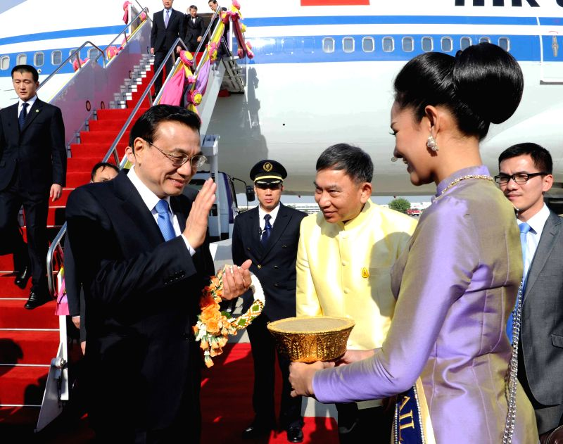 Chinese Premier Li Keqiang (L, front) is greeted upon his arrival in Bangkok, Thailand, Dec. 19, 2014. Li arrived here Friday to attend the fifth summit of the ...