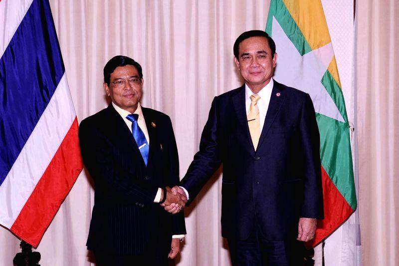 Thai Prime Minister Prayuth Chan-ocha (R) shakes hands with Myanmar Vice President U Nyan Tun at Government House in Bangkok, Thailand, Jan. 29, 2015. ... - Prayuth Chan