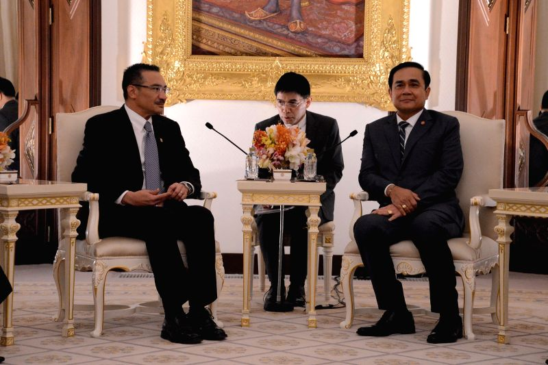 Thai Prime Minister Prayut Chan-o-cha (R) meets with Malaysian Defense Minister Hishammuddin Hussein (L) at the Government House in Bangkok, Thailand, Jan. 30, ... - Prayut Chan