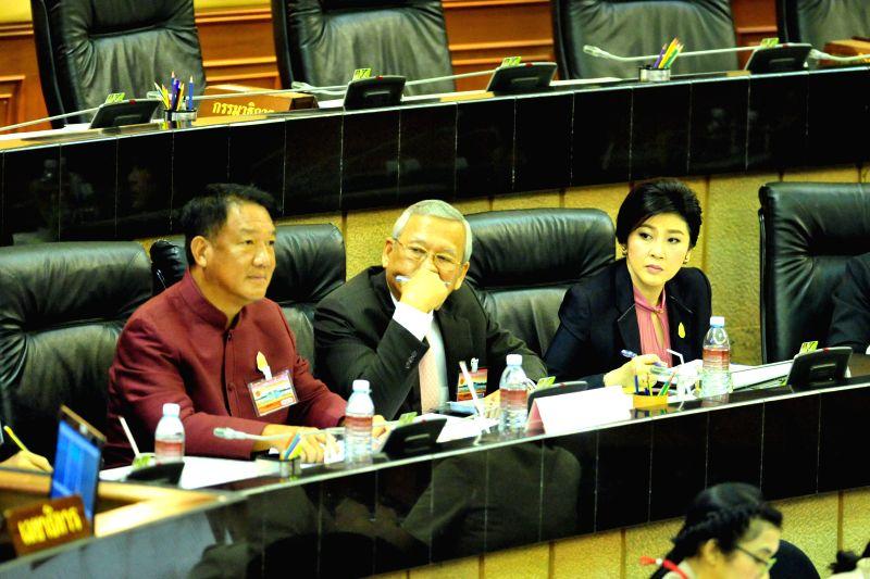 Former Thai Prime Minister Yingluck Shinawatra (R) arrives at parliament in Bangkok, Thailand, Jan. 9, 2015. The impeachment case against former Thai Prime Minister . - Yingluck Shinawatra