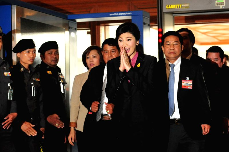 Former Thai Prime Minister Yingluck Shinawatra (C) arrives at parliament in Bangkok, Thailand, Jan. 9, 2015. The impeachment case against former Thai Prime Minister . - Yingluck Shinawatra