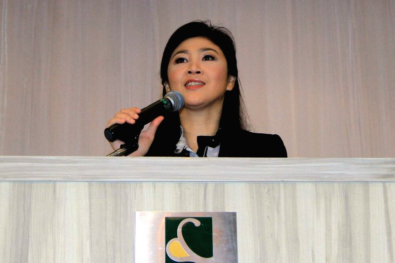 Former Thai premier Yingluck Shinawatra speaks during a press conference in Bangkok, Thailand, July 18, 2014. Yingluck assured on Friday she will return home after .