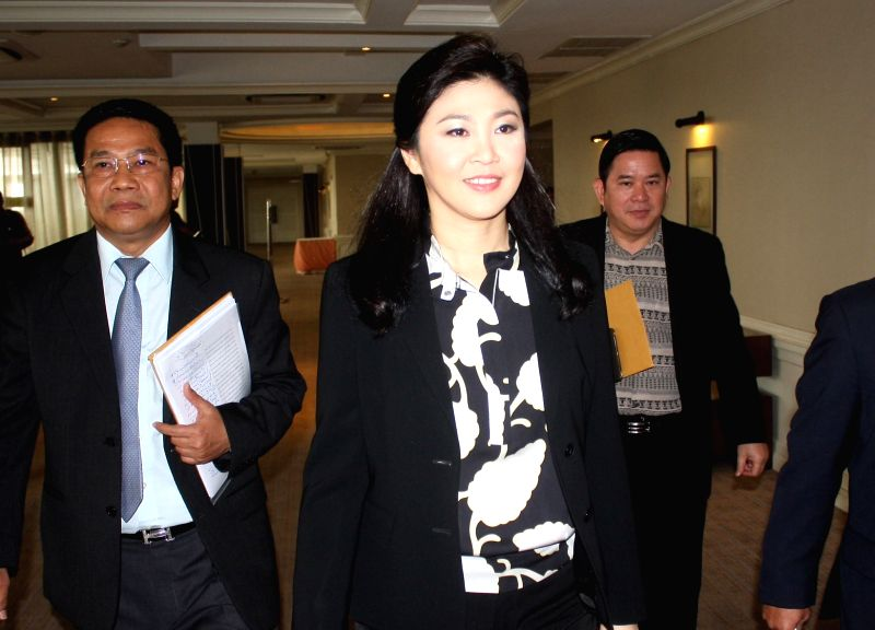 Former Thai premier Yingluck Shinawatra (2nd L) attends a press conference in Bangkok, Thailand, July 18, 2014. Yingluck assured on Friday she will return home ...