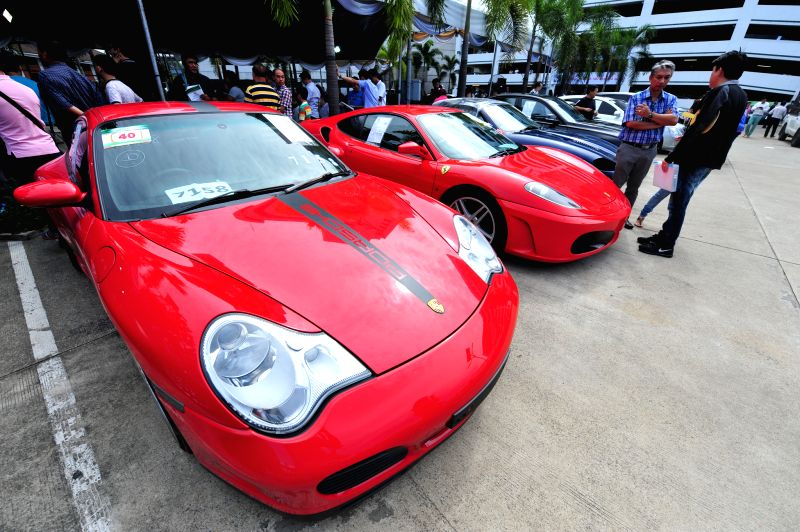 People look at smuggled cars during an auction at Thai Customs Department in Bangkok, Thailand, July 3, 2014.  ****Authorized by ...