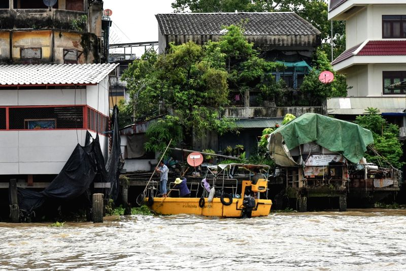 BANGKOK, June 12, 2017 - Workers clear the water hyacinth and other wastes on the Chao Phraya River in Bangkok, Thailand, June 12, 2017. A massive operation has been launched earlier to remove urban ...