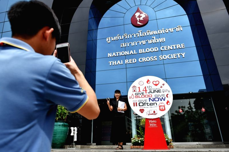 BANGKOK, June 14, 2017 - A blood donor poses for photo in front of the Thai National Blood Centre in Bangkok, Thailand, on June 14, 2017. Since 2004, the World Blood Donor Day has been observed on ...