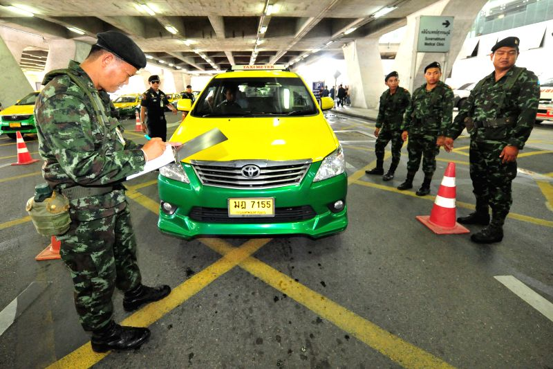 Thai soldiers check taxi services at Suvarnabhumi airport in Bangkok, Thailand, on June 19, 2014. The ruling military junta promised major changes of taxi service ..