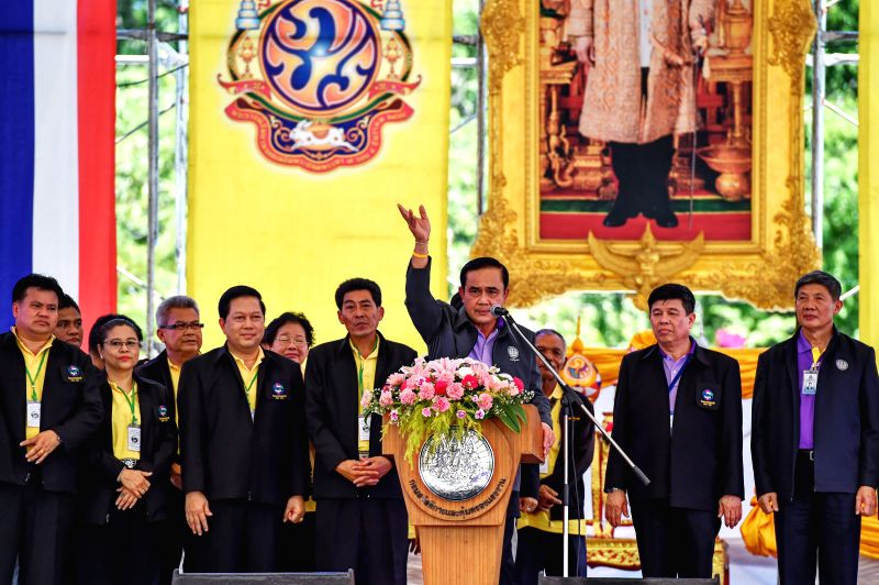 Thai Prime Minister Prayuth Chan-ocha (C) delivers a speech during the International Labor Day celebration at the Sanam Luang square in Bangkok, Thailand, May 1, ... - Prayuth Chan