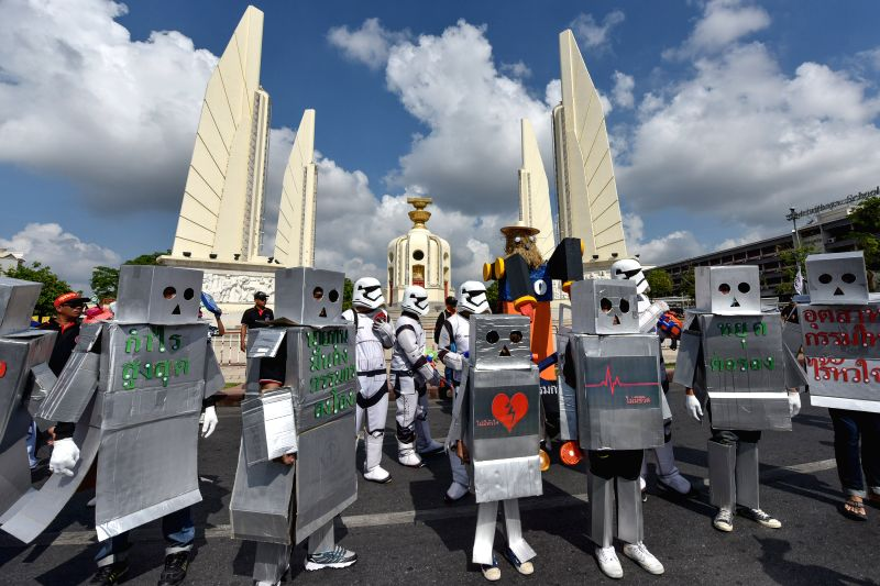BANGKOK, May 1, 2017 - People call for labour rights protection against the background of automated mass production as they attend a rally in front of the Democracy Monument on the International ...