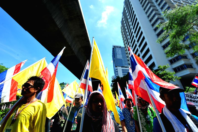 Anti-government protesters attend a demonstration in Bangkok, Thailand, May 12, 2014. Thai anti-government protesters began to move their rally site to the area near