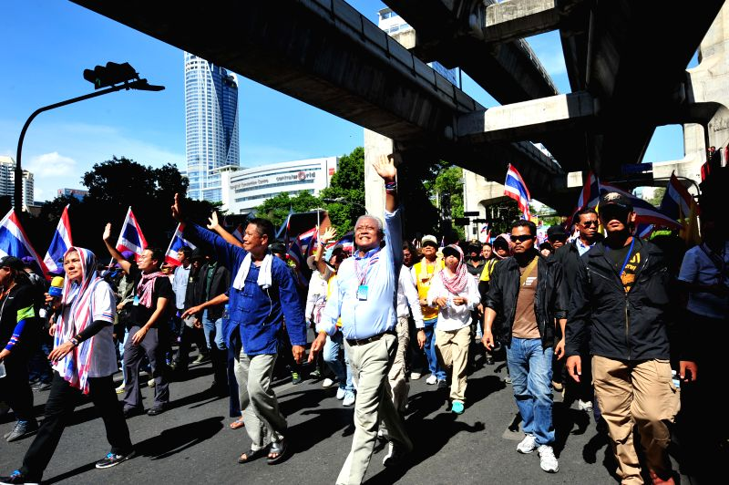 Anti-government protest leader Suthep Thaugsuban (C) attends a protest in Bangkok, Thailand, May 12, 2014. Thai anti-government protesters began to move their rally .