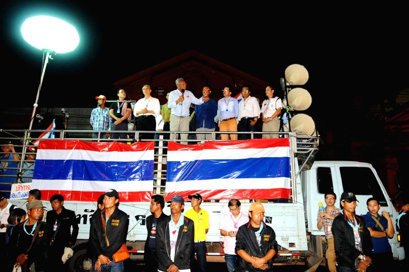 Anti-government protest leader Suthep Thaugsuban (C) speaks to supporters on a truck in front of Parliament House in Bangkok, Thailand, May 12, 2014. Thai ...