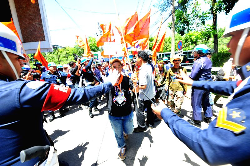 Anti-government protesters rally at Air Force Academy compound in Bangkok, Thailand, May 15, 2014. Anti-government protesters in Thailand entered the military ...