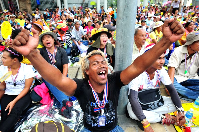 Thai anti-government protesters take part in a rally in front of the Parliament House as senators debate to find solutions to the country's political conflict in ...