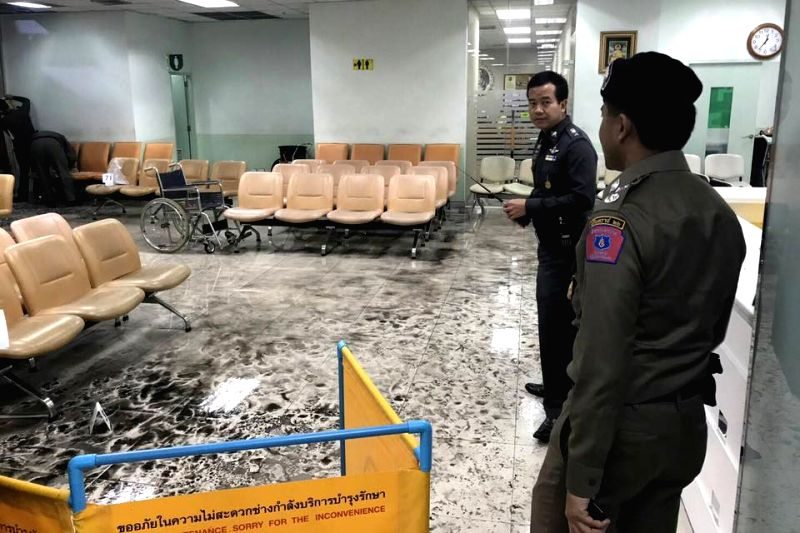 BANGKOK, May 22, 2017 - Investigators work on the site of explosion in Bangkok, Thailand, on May 22, 2017. A blast at an army hospital in the heart of the Thai capital Bangkok on Monday injured 25 ...